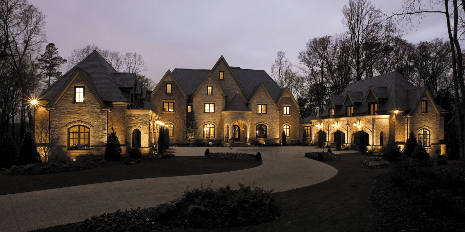 luxury house with dim light outside